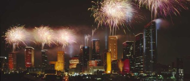 Fireworks display light up downtown Houston at night.
